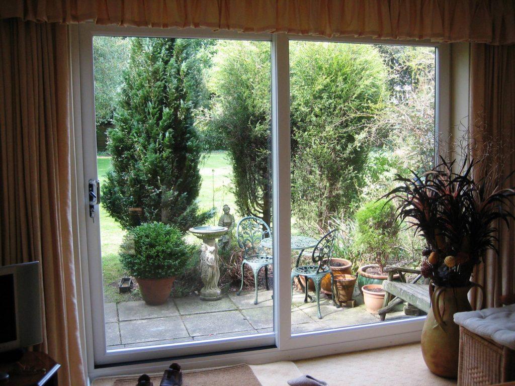 Sliding patio doors sci windows for Patio doors with side windows