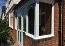 White Flush Sash Casements Including a Porch