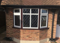 Two Coloured Casement Windows