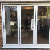White PVCu bifolding doors
