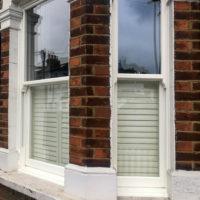 Ultimate Rose Woodgrain Sliding Sash Windows