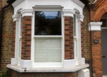Ultimate Rose Woodgrain Sliding Sash Windows
